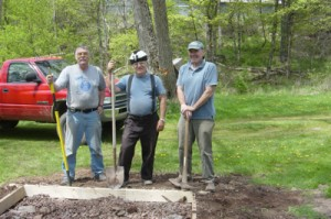 Left to right: Grumpy Old Men Frank Hartung, Bill Piervincenzi and Jack McShane don't look so grumpy as they install the memorial bench in Ballantine Park