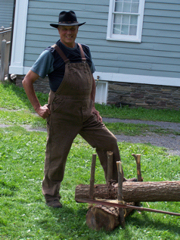 Don Liddle, along with brother Doug, demonstrate how to make a pump log