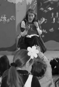 """Actress Betty Aberlin, the former """"Lady Aberlin"""" from Mister Roger's Neighborhood, reading to children at the Andes Central School Dr. Seuss Party"""