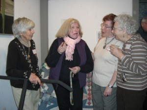 Mary Tucker, Merna Popper, Rima Walker and Phyllis Galowitz enjoy food and friends at the Silent Auction