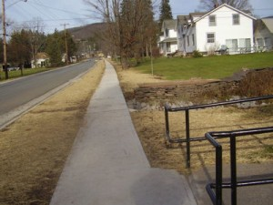 Seemingly endless sidewalk along Lower Main from the Post Office