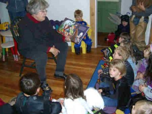 Left:  Librarian Gloria Carlson reads to the tiny trick or treaters who stopped by the Andes Public Library on Halloween.