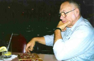 Gerald Norris enjoying a game of checkers