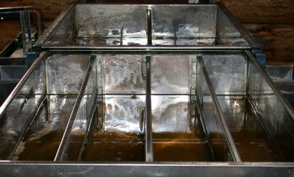 Evaporator pans in which the sap is processed