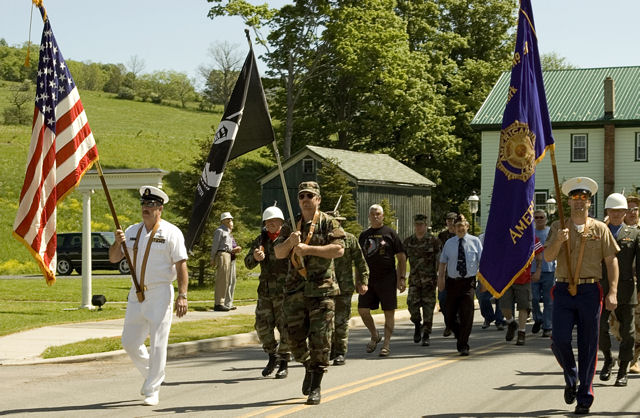 Veterans Dale Tait, Bill Drew and John Andrews carry the colors for the Memorial Day parade   Photo by Joe Damone