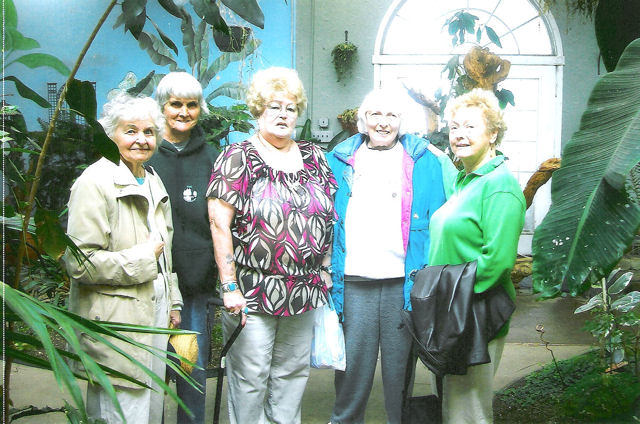 Louise Redden, Betty Little, Evelyn Norris, Marie Gladstone and Joi Brundege enjoy the beauty of the Joseph J. Popp Butterfly Conservatory in Oneonta