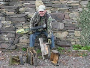 Jack McShane with some of the birdhouses destroyed by the bear
