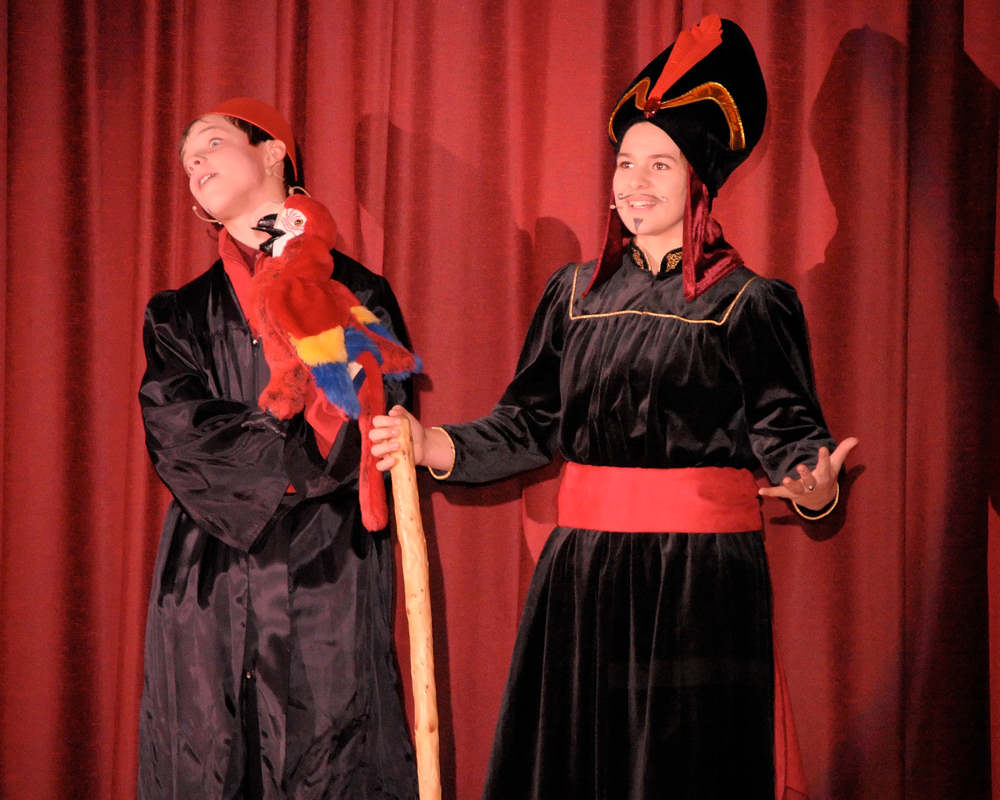 Jonathan Andrews as Iago the Parrot and Ashley Terry as Jafar - photo by Joe Damone