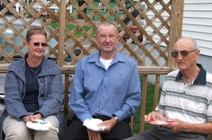 Dorothy Rider, Walter Gladstone and Wayne Decker enjoy refreshments on the deck at the Library Birthday Party